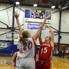 RYAN HUTTON/ Staff photo.   Londonderry's Taylor Collins (20) blocks a shot by Pinkerton's Kayla Stacy (15) during the first half of Thursday night's game.