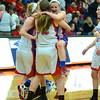 RYAN HUTTON/ Staff photo.  Londonderry's Jaclyn Luckhardt (14) jumps into the arms of teammate Ashley Berube (32) in celebration of the team's victory over Pinkerton Academy.