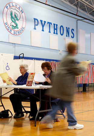 A voter proceeds to the voting booth after collecting her ballot at Pelham High School in Pelham. Photo by Mary Schwalm