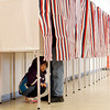 Katherine Houghton, 5, waits for her dad John to finish voting at Rockingham Park in Salem. Photo by Mary Schwalm