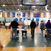 Voters line up to get their ballots in the gym at Pelham high school in Pelham.  Photo by Mary Schwalm.