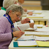 Ballot Clerk Kathleen Hunt goes over the voter roll at the polls at Hampstead Middle School.  Photo by Ryan Hutton.