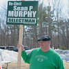 Incumbent Selectman Sean Murphy holds a re-election sign outside of the polls at Hampstead Middle School on Tuesday.  Photo by Ryan Hutton.
