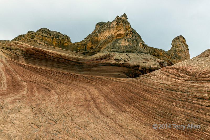 White, red and yellow sandstone with capstone and striations, White Pockets, Vermillion Cliffs National Monuments, Arizona
