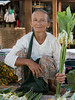 Woman selling flowers at the market, Nyaunshwe (near Inle Lake) Myanmar