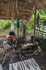 Blacksmith pounding a blade while a woman works a hand bellows, Inle Lake, Market, Myanmar (best largest)