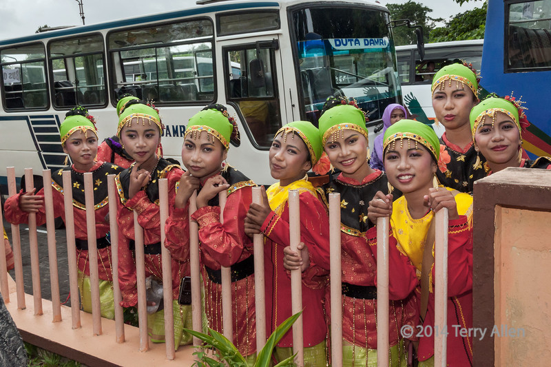 Girls in traditional dress waiting for bus, Belitung, Sumatra