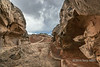 Sandstone formations with wave formation in the background, White Pocket, Vermillion Cliffs NM, Arizona