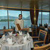 MS Statendam dining room, Vancouver, BC.  The harbour and the north shore mountains can be seen through the windows.
