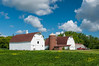 Two white barns and a farm field near Grand Forks, North Dakota, USA, America.
