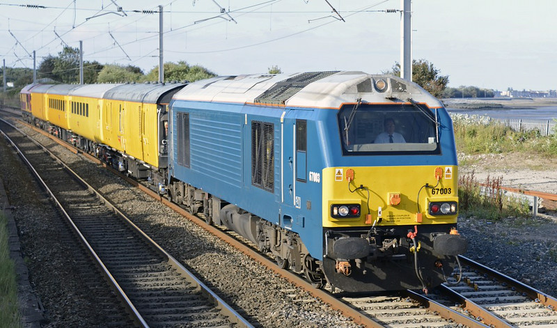 67003 & 67020, 1Q26, Hest Bank, Tues 26 August 2014 - 0859.  The Arriva blue Skip leads a Derby - Craigentinny move.  The consist was generator van 6263, plain line pattern recognition (PLPR) coach 72631, and structure gauging train support coaches 73630 & 99666.