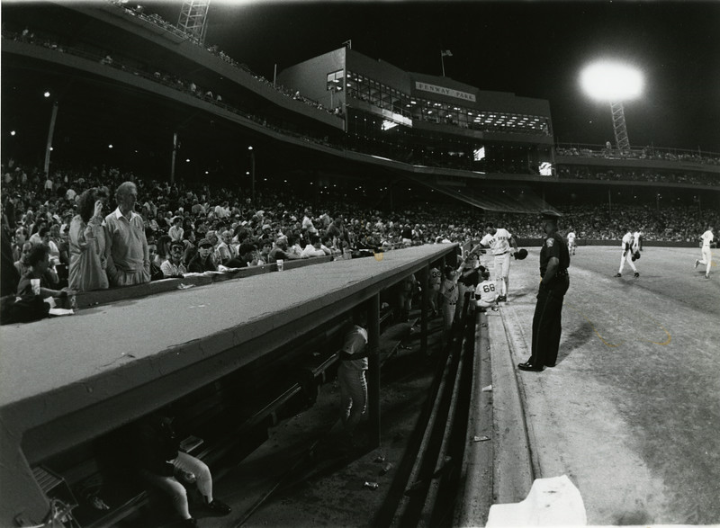 Player enters the dugout at Fenway Park