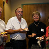 Ray Savolainen, Marshall Wright, Betsy Stanga Wright, and Suzanna Seykora Savolainen partake of appetizers during the Saturday night gathering at the History Center.