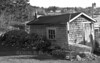 fishing shack for lobster gear with buoys, traps and line, Friendship, Maine in black and white