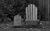 Adirondack chairs, adult and child, study in black and white, Thuya Gardens, Northeast Harbor, Maine