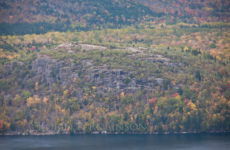 Acadia National Park looking west from Cadillac Mountain across Eagle Lake with fall foliage in a rain storm, Mount Desert Island Maine, autumn scenic