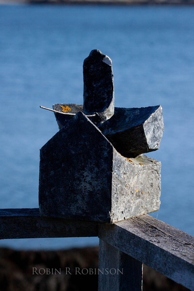 plaster sculpture of figure fishing from boat, modern, done by Peter B Riley, 1980