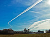 Maine scenic contrails over field with classic, Federal style architectural houses. Phippsburg