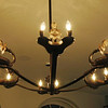 Bronze chandelier incorporating casts of antique Roman oil lamps.
