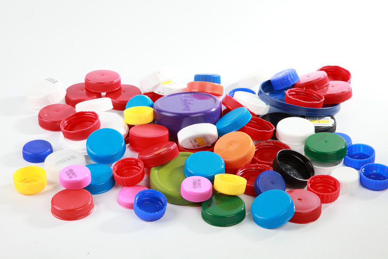 Brightly coloured plastic bottle tops that can be used to create craft items