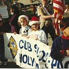 Britt holding the banner at the parade for Brandon's cub scout troop
