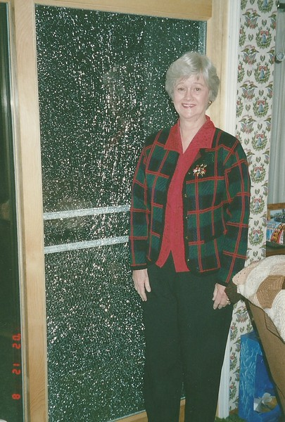 Mom next to the shattered glass door from a hockey puck!!!