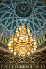 Decorative chandelier with ceiling detail in the prayer room of the Grand Mosque in Muscat, Oman.