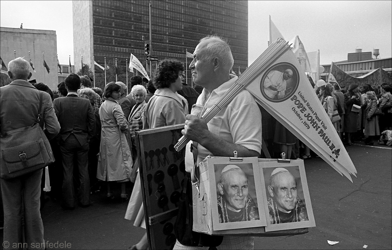 Pope John Paul II came to New York in October of 1979.  This is outside the UN where people were gathered to see him before he went in to speak.  I was working about a block away back then and went over on my lunch break - shot a couple of rolls of the crowds - never did see the Pope... except in this photo :-)