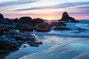 """Sunset Swirls""<br /> <br /> Sunset color in the sky and sea at Indian Beach, Ecola State Park, Oregon, USA."