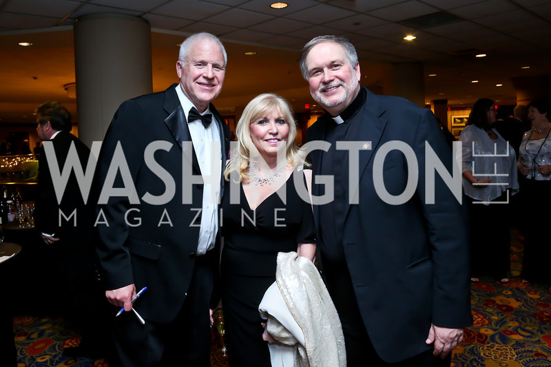 Jim Pinkelman, Christina Cox, Father Steve Shafran. Photo by Tony Powell. 2014 Catholic Charities Gala. Marriott Wardman Park. April 12, 2014