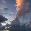 Clouds and squall; also note the rain falling from the nearer, sunlit cloud.