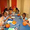 Pumpkin decorating at the Halloween Party. Girls' Leadership Institute, October 30, 2013.