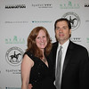 Lisa Hathaway Stella with her husband.  Winter Ball 2014, Enchantment in the Secret Garden, March 1, 2014 - Step and Repeat.