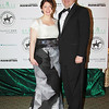 Fiona Grant Small and husband.  Winter Ball 2014, Enchantment in the Secret Garden, March 1, 2014 - Step and Repeat.