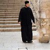 A priest outside the Church of the Holy Sepulchre in Jerusalem