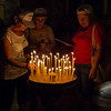 Lighting candles in the Church of the Holy Sepulchre - Jerusalem
