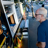 Ken Nowell, of Chico, waits for his grilled cheese sandwich from the Mayhem Gourmet Grilled Cheese food truck at the Thursday Night Market on July 24, 2014, in Chico, California. Dan Reidel — Enterprise-Record