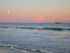 Shrimp boat out of Cherry Point on Wadlamaw Island, SC is fishing off the Kiawah Island beach as the moon is rising on the horizon.