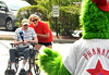 A resident takes a swing during a baseball game at the Dock Terrace Fifth Annual Senior Olympics in Towamencin.   The Philly Phanatic made a guest appearance, delivered high-fives,  posed for pictures and videos, and joined the game.    Youngsters from nearby Salford Mennonite Childcare Center finished the game begun by the seniors.    Thursday,  August 21, 2014.    Photo by Geoff Patton