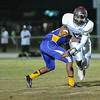 Nash Central QB Corey Pearce # 12 during tonights game.Tarboro defeats Nash Central  33-6 in the season opener. Friday August 22, 2014 in Tarboro, NC (Photos By Anthony Barham)