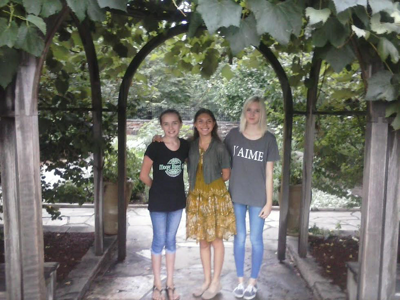 Celina from Germany with a host family friend, Kandice, and her host mom's granddaughter, Heaven, at the Botanical Gardens in Colorado.