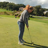 Sina from Germany practices her short game during her welcome orientation in Wisconsin.