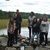 Keanu from Germany, Nina from Germany, Camilla from Colombia, Isabella from Germany, Isabel from Germany, Marta from Spain, and Christine from Norway get their feet wet in the headwaters of the Mississippi River during their orientation in Minnesota.