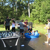 Students and host families in North Carolina enjoy a water fight on a hot day.