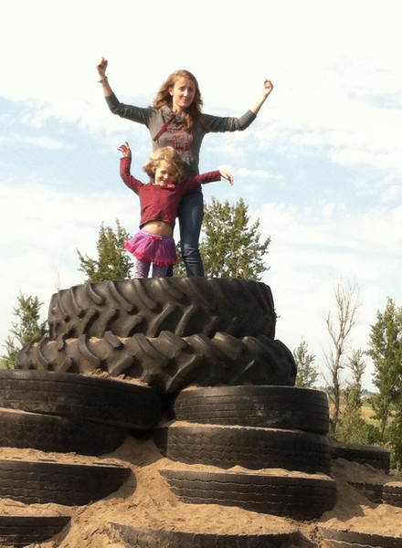 Mathilde from Belgium enjoys a day at the apple orchard with her host sister in Nebraska.
