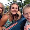 Juni Malene and Elisabeth from Norway and Juni Malene's host brother Alex are ready to ride a roller coaster!