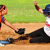 Lamar 14U shortstop Sheridan Choat attempts to tag out a SE Denver player at second base during the first game of the championship bracket on Sunday morning in the Babe Ruth 14U Midwest Plains Regional Tournament.
