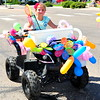 A youngster on a four wheeler makes her way down the parade route during the 2014 Sand & Sage Parade on Saturday, Aug. 9.