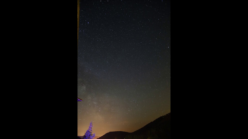 This time lapse video of the Milky Way moving west was shot in the Black Forest (Germany) over 2 hours and 21 minutes and compressed into 31 seconds.  The location is north of Freudenstadt which is a little more than 48 degrees north latitude, which meant that morning twilight came early.  There are a number of streaks that appear in the video that are satellites orbiting high enough that they are still lite by the sun.