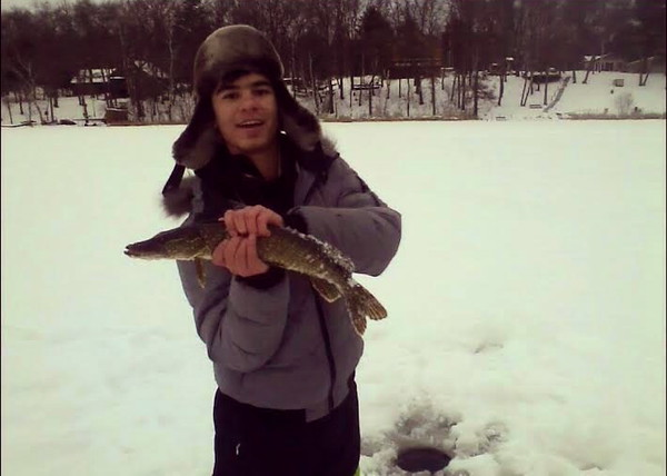 Masrur from Tajikistan catches a big one on his first ice-fishing trip ever in Wisconsin.